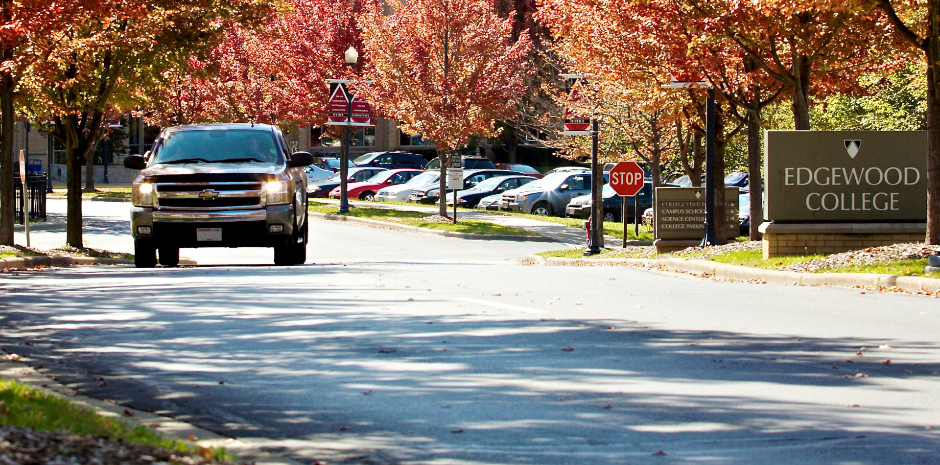 Truck leaving Edgewood College in the Fall.