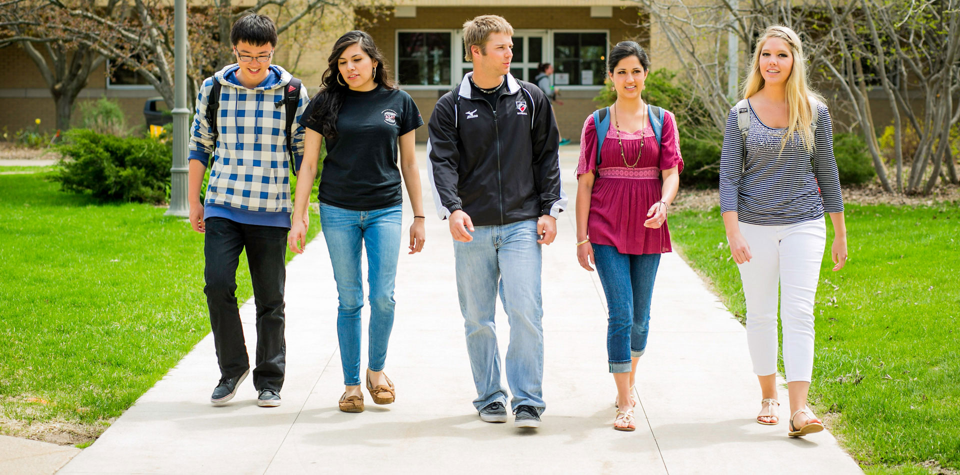 Undergrad students walking in front of the library.