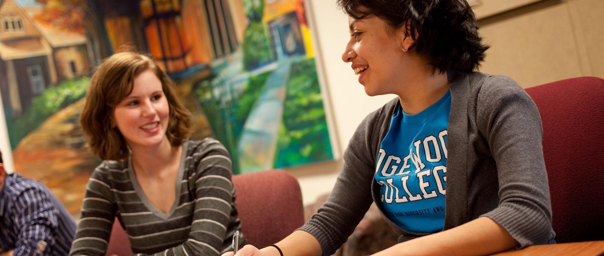 Female undergrad students conversing.
