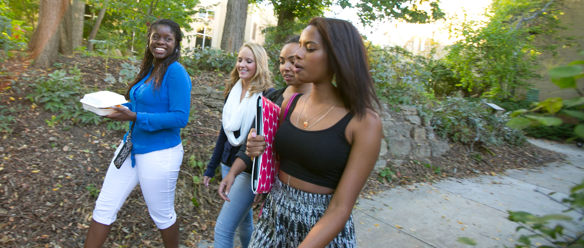 Undergrad female students walking outdoors.