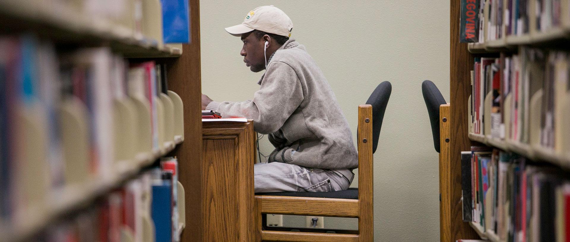 Undergrad-Male-Library-Shelves