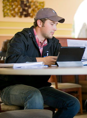 Business student studying in Phil's Cafe.