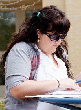 Elementary Education student studying outside.