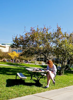 Environmental Science student studying outside.
