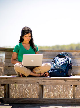 Environmental Studies student studying by Lake Wingra.
