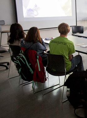 Students watching a film.