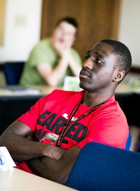 Global Studies student listening in class.