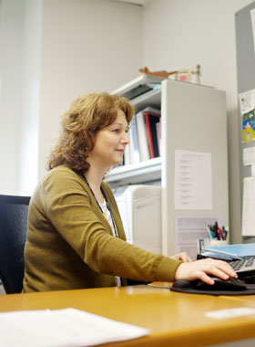 Female working at a computer in an office.
