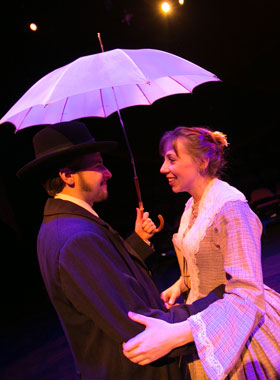 Two characters embracing in a theater production.