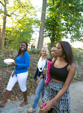 Women's and Gender Studies students walking outdoors.