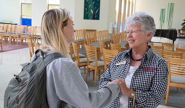 Mary Ellen Gevlinger In chapel with student