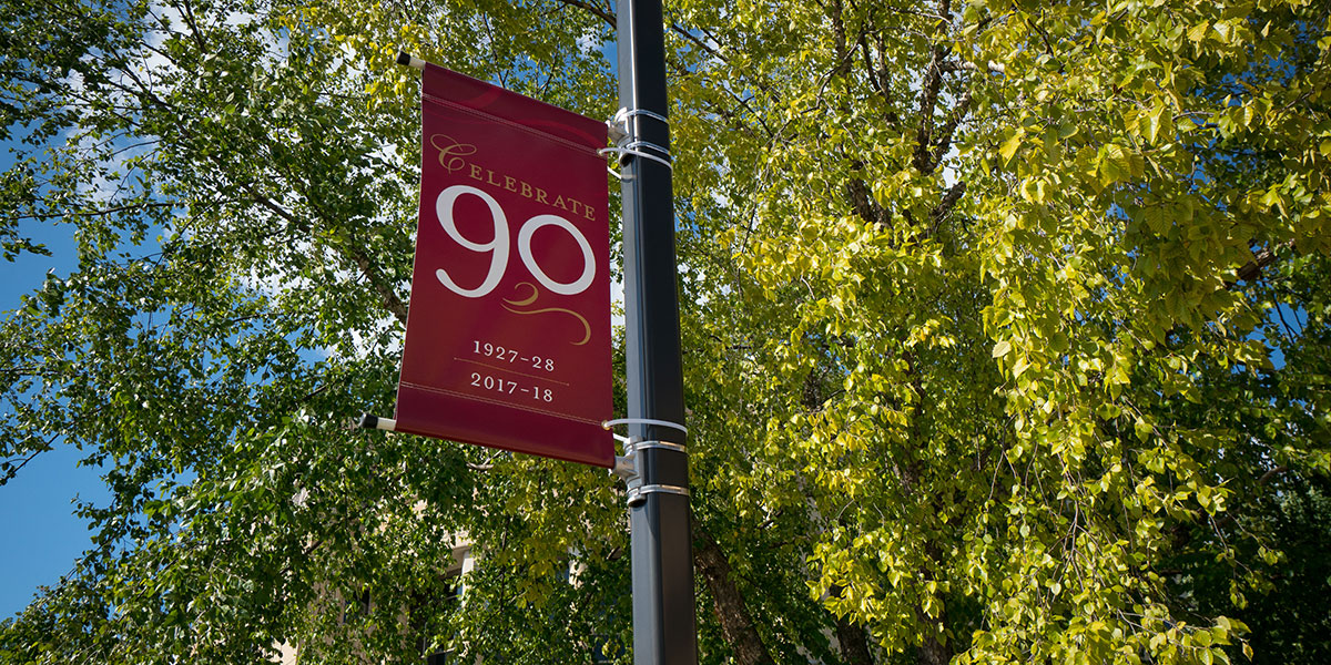 Banner on campus celebrating 90th Anniversary