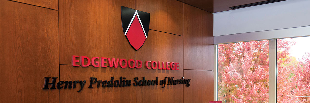 Edgewood College, Henry Predolin School of Nursing seal on wood-panel wall